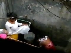 Indian housewife bathing